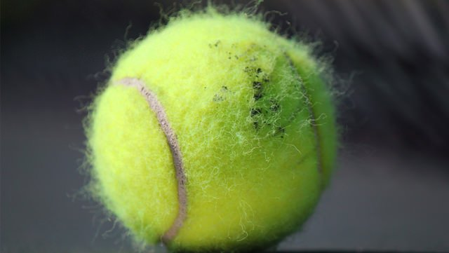 why is there fuzz on a tennis ball